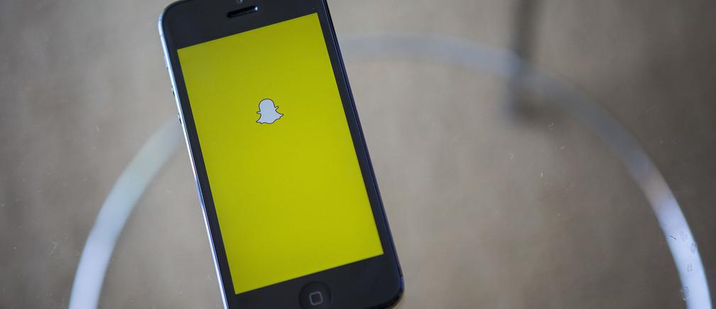 A portrait of the Snapchat logo in Ventura, California December 21, 2013