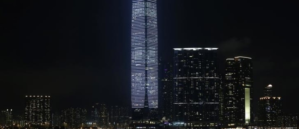 "A tourist junk sails past the 118-storey-high skyscaper International Commerce Centre (ICC), the highest building in Hong Kong, during an audio-visual show ""alpha pulse"" by German artist Carsten Nicolai, as part of the Art Basel programme, in Hong Kong May 15, 2014. The 50-minute show generates a light pattern that pulsates in a synchronized frequency across the entire facade of ICC, according to the official press release.  REUTERS/Bobby Yip  (CHINA - Tags: SOCIETY TRAVEL)"