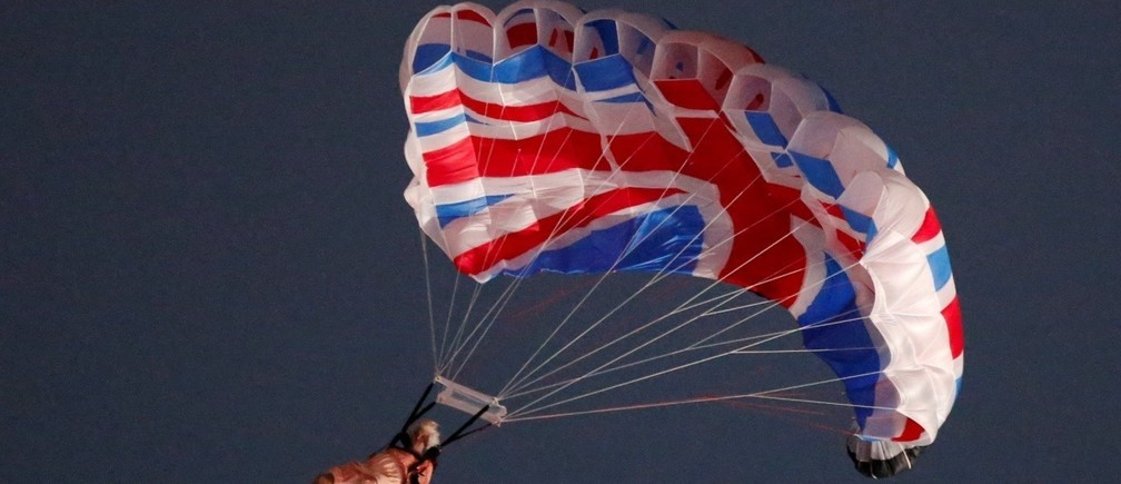 A performer playing the role of Britain's Queen Elizabeth parachutes from a helicopter during the opening ceremony of the London 2012 Olympic Games at the Olympic Stadium July 27, 2012.