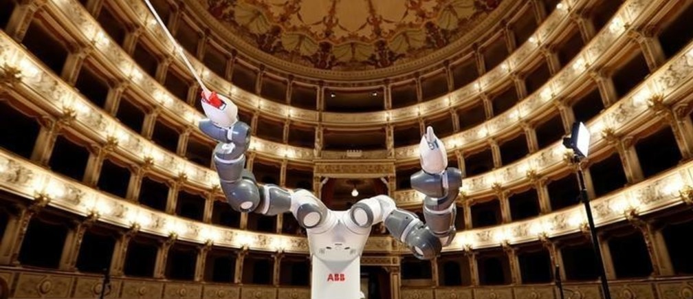 Humanoid robot YuMi is seen during the rehearsal at the Verdi Theatre in Pisa, Italy September 12, 2017. YuMi will conduct the Lucca Philharmonic Orchestra, performing a concert alongside Italian tenor Andrea Bocelli (not pictured). REUTERS/Remo Casilli