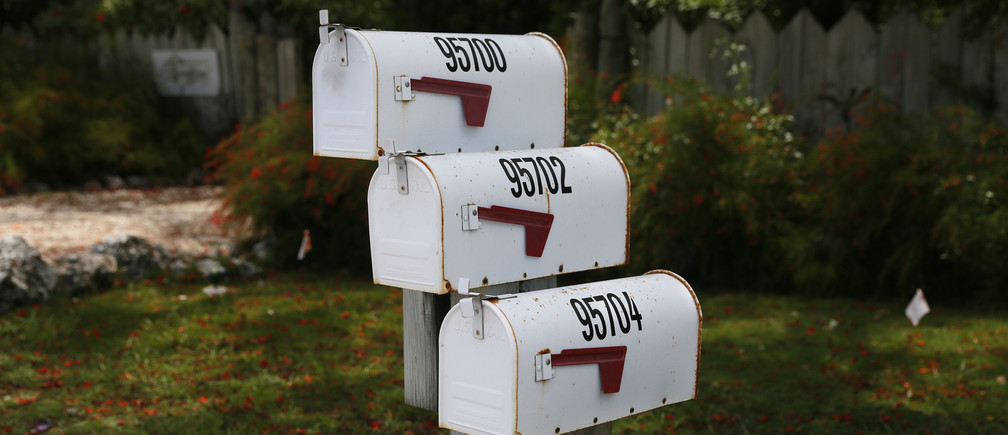Three mailboxes are seen along the highway US-1 in the Lower Keys near Key Largo in Florida, July 10, 2014. The Florida Keys are famous for their diving, but they are less well known for another quirky attraction: the mailboxes residents use to decorate their driveways. From a fiberglass manatee in lipstick to a small white church, Reuters photographer Wolfgang Rattay documented this unusual aspect of local culture as he drove along the Ocean Highway that connects the islands. Picture taken July 10, 2014.   REUTERS/Wolfgang Rattay (UNITED STATES - Tags: SOCIETY TRAVEL)ATTENTION EDITORS: PICTURE 15 OF 18 FOR PACKAGE 'FLORIDA MAILBOXES - MANATEES, CHURCHES AND CATS'TO FIND ALL IMAGES SEARCH 'RATTAY MAILBOX' - GM1EA810RFF01