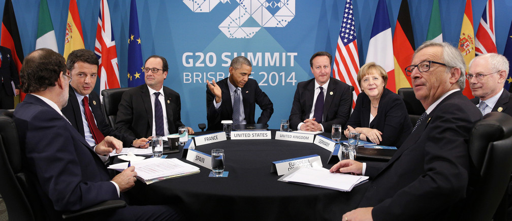 U.S. President Barack Obama (C) gestures as he meets with European leaders to discuss the situation in Ukraine, at the G20 in Brisbane November 16, 2014. Pictures are (L-R) Spanish Prime Minister Mariano Rajoy, Italian Prime Minister Matteo Renzi, French President Francois Hollande, Obama, British Prime Minister David Cameron, German Chancellor Angela Merkel, European Council President Herman Van Rompuy and European Commission President Jean-Claude Juncker.