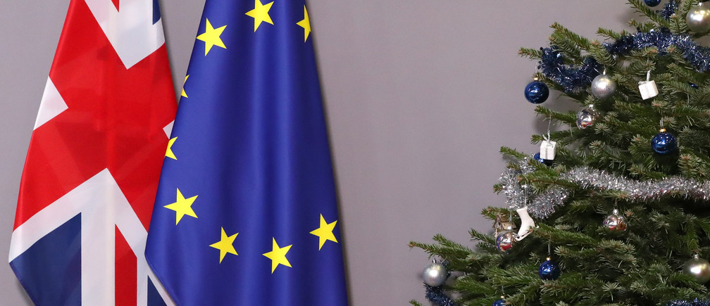 British and European Union flags are seen next to Christmas tree before arrival of British Prime Minister Theresa May to meet European Council President Donald Tusk, at the EU Council headquarters in Brussels, Belgium December 11, 2018. REUTERS/Yves Herman - RC1C3F63CB50