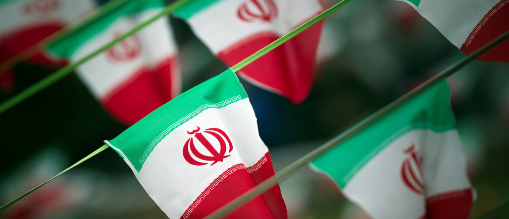FILE PHOTO: Iran's national flags are seen on a square in Tehran February 10, 2012, a day before the anniversary of the Islamic Revolution. REUTERS/Morteza Nikoubazl/File Photo - S1BEUIFKRGAA