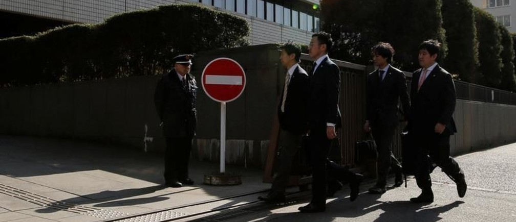 Lawyers representing a group of seven people who had invested in digital money at Coincheck, enter the Tokyo District Court to filed a suit in Tokyo, Japan, February 15, 2018. REUTERS/Toru Hanai - RC1FE8969FB0