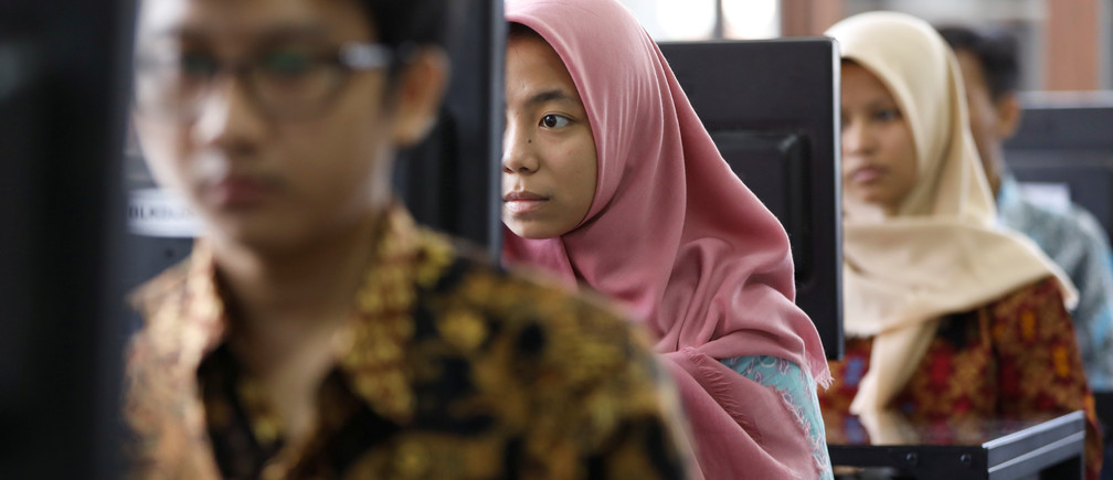 Indonesian students learn digital skills at a government-run training centre.