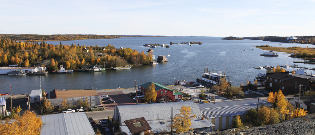 Great Slave Lake and Jolliffe Island are seen from the Pilot Monument in Yellowknife, Northwest Territories, in this picture taken September 22, 2015. Each winter, in the far reaches of Canada's north, a highway of ice built atop frozen lakes and tundra acts as a supply lifeline to remote diamond mines, bustling with traffic for a couple of months before melting away in the spring.  Due to unseasonably warm weather, this year the world's busiest ice road is running late.  Picture taken on September 22, 2015.   REUTERS/Susan Taylor - TM3EBAF1BRF01