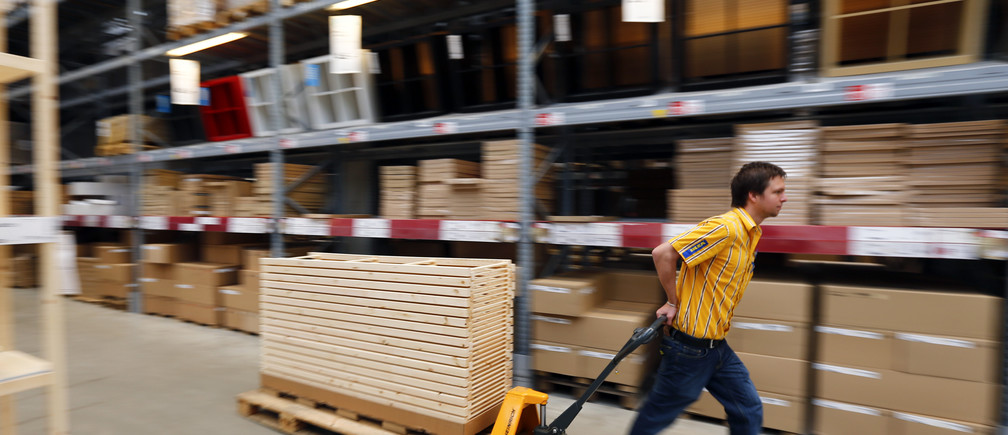 """An employee of Swedish retailer IKEA is pictured in Taufkirchen near Munich January 22, 2013. IKEA Group, the world's biggest furniture retailer, posted a record net profit on Wednesday for the 2011/12 year, helped by sales and market share growth as budget design enticed austerity-hit shoppers. Net profit at the privately-held Swedish firm, known the world over for low-price, self-assembly, flat-packed furniture, rose 8 percent to 3.2 billion euros ($4.3 billion) in the 12 months through last August.IKEA says it is relatively resilient to economic downturns as these make cost conscious consumers turn to cheaper goods.""""Customers are getting more and more value conscious, which makes IKEA a better choice,"""" IKEA said in an annual summary. REUTERS/Michael Dalder (GERMANY - Tags: BUSINESS) - BM2E91M15W301"""
