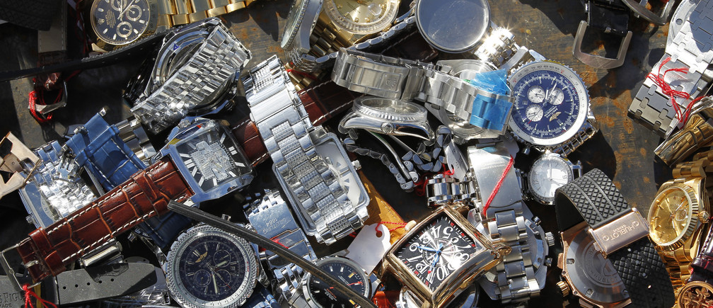 Several thousand fake Swiss watches, confiscated by Swiss customs throughout 2010, are laid out on the ground ready to be destroyed, at the Bern-Belp airport in Bern October 28, 2010.