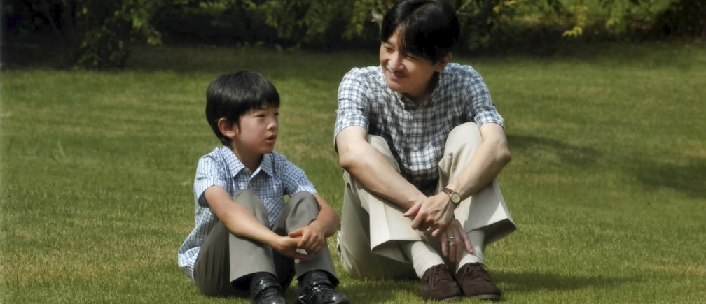 Japan's Prince Hisahito (L) and his father Prince Akishino talk as they sit on the grounds of the Akasaka Detached Palace in Tokyo in this handout picture taken August 16, 2015, and provided by the Imperial Household Agency of Japan. Prince Hisahito, the only grandson of Japan's Emperor Akihito and Empress Michiko, celebrates his ninth birthday on September 6, 2015.  REUTERS/Imperial Household Agency of Japan/Handout via Reuters   ATTENTION EDITORS - THIS PICTURE WAS PROVIDED BY A THIRD PARTY. REUTERS IS UNABLE TO INDEPENDENTLY VERIFY THE AUTHENTICITY, CONTENT, LOCATION OR DATE OF THIS IMAGE. FOR EDITORIAL USE ONLY. NOT FOR SALE FOR MARKETING OR ADVERTISING CAMPAIGNS. THIS PICTURE IS DISTRIBUTED EXACTLY AS RECEIVED BY REUTERS, AS A SERVICE TO CLIENTS - GF10000194817