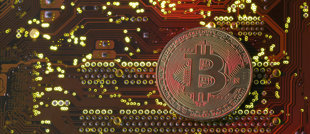 A copy of bitcoin standing on PC motherboard is seen in this illustration picture, October 26, 2017. Picture taken October 26, 2017. REUTERS/Dado Ruvic - RC1B7D9AB540