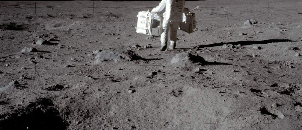 Apollo 11 lunar module pilot Buzz Aldrin carries equipment for the Passive Seismic Experiments (in his left hand) and the Laser Ranging Retroreflector (in his right) to the deployment area at Tranquility Base in the Sea of Tranquility on the moon, July 20, 1969.  Neil Armstrong/NASA/Handout via REUTERS   ATTENTION EDITORS - THIS IMAGE HAS BEEN SUPPLIED BY A THIRD PARTY. - RC1775AC2200