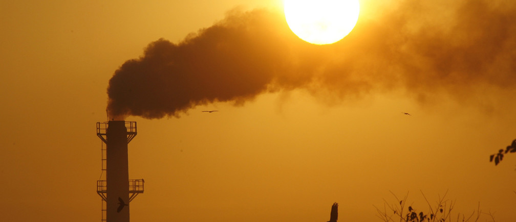 Smoke rises from a chimney of a garbage processing plant on the outskirts of the northern Indian city of Chandigarh.