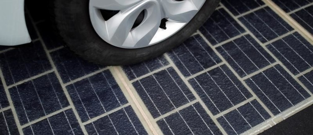 The tyres of an automobile are seen on a solar panel road during its inauguration in Tourouvre, Normandy, northwestern France, December 22, 2016. REUTERS/Benoit Tessier - RC171F93E960