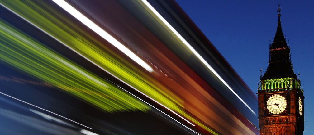Light trails shine from a passing bus in front of Big Ben and the Houses of Parliament in London, November 17, 2011.  REUTERS/Luke MacGregor  (BRITAIN - Tags: POLITICS TRAVEL) - LM1E7BH1DL001