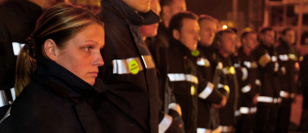 British firefighters at Cowcaddens station in Glasgow begin their strike, November 13, 2002.  Firefighters began a 48-hour strike for more pay at 1800 GMT on Wednesday for the first time in a quarter of a century but promised emergency cover in the event of a catastrophic incident as Britain goes on heightened terror alert in the run-up to [Christmas]. - RTXLMLZ