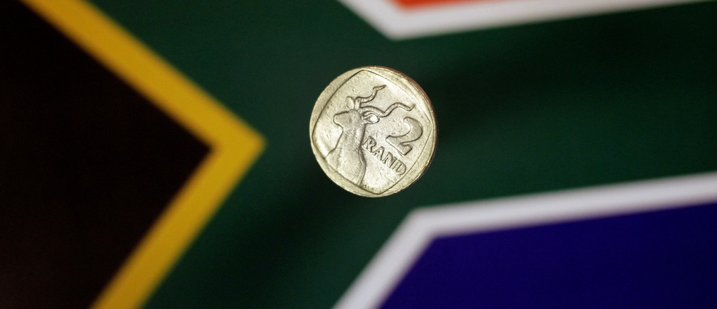 Illustration photo shows a two-rand coin above a South Africa flag April 12, 2017.   REUTERS/Thomas White/Illustration - RC16482C97B0
