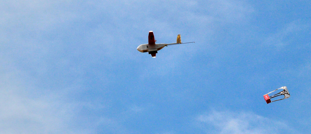 A drone drops its first blood delivery in the compound of Kabgayi hospital south of Rwanda capital Kigali where Zipline, a California-based robotics company delivered their first blood to patients using a drone October 13, 2016. Picture taken October 13, 2016