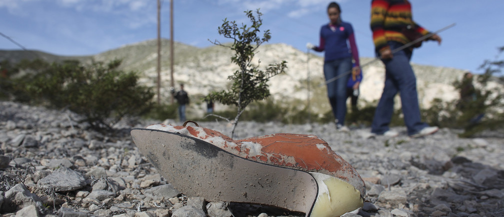 Women take part in the search of missing persons in an area near the village of La Union, on the outskirts of Torreon, in the Mexican state of Coahuila February 21, 2015. For the past two months, relatives of missing people in the Mexican city of Torreon have met every Saturday to personally look for missing relatives after the city was severely hit by an increase in murders, due to an intense struggle between rival drug gangs. The Zetas cartel arrived in Torreon in mid-2007 and started battling against the Sinaloa cartel for control over this centre of manufacturing, mining and farming once seen as a model for progress, which then became one of Mexico's most dangerous cities. Picture taken February 21, 2015.