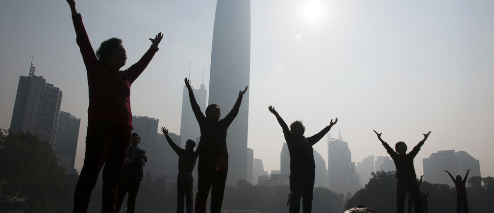 Residents do morning exercises at a park on a hazy day in Shenzhen, Guangdong province February 12, 2015.