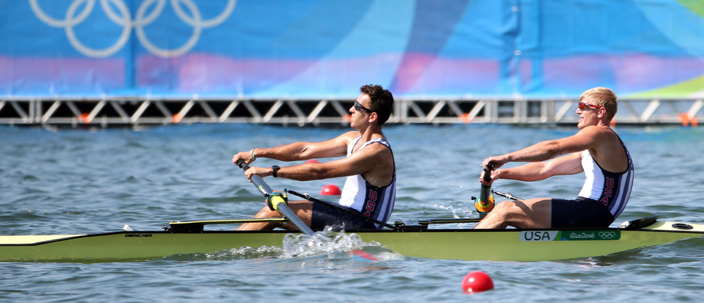 2016 Rio Olympics - Rowing - Preliminary - Men's Pair Heats - Lagoa Stadium - Rio De Janeiro, Brazil - 06/08/2016. Anders Weiss (USA) of USA and Nareg Guregian (USA) of USA compete. REUTERS/Carlos Barria FOR EDITORIAL USE ONLY. NOT FOR SALE FOR MARKETING OR ADVERTISING CAMPAIGNS. - RIOEC861553SW