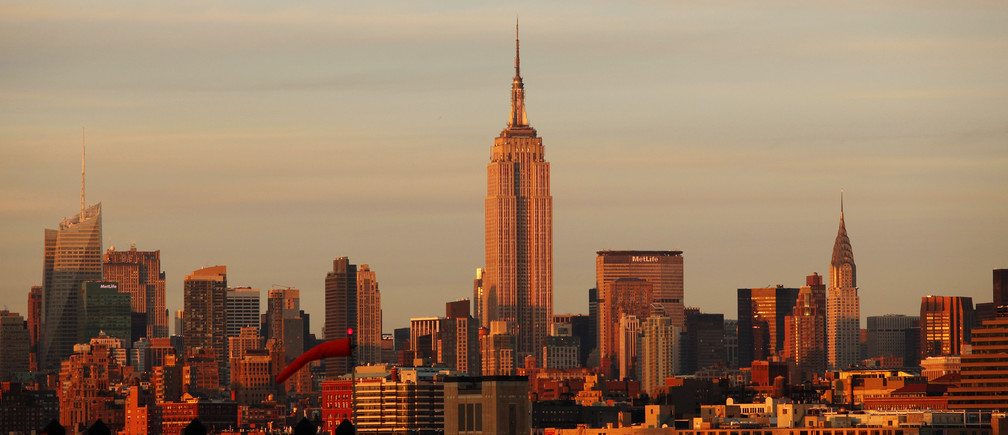 The Empire State Building (C) sits between the Bank of America building (L) and the Chrysler Building (R) at sunset in New York, September 11, 2010.