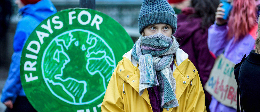 """Swedish environmental activist Greta Thunberg attends a climate strike of the """"Fridays For Future"""" movement outside the Swedish parliament Riksdagen in Stockholm, December 20, 2019. TT News Agency/Pontus Lundahl via REUTERS   greta thunberg no one is too small to make a difference environment renewable solar energy change transition friendly environment carbon footprint carbon emissions reduction change natural climate change global warming air pollution clean energy power renewables plastic plastics"""
