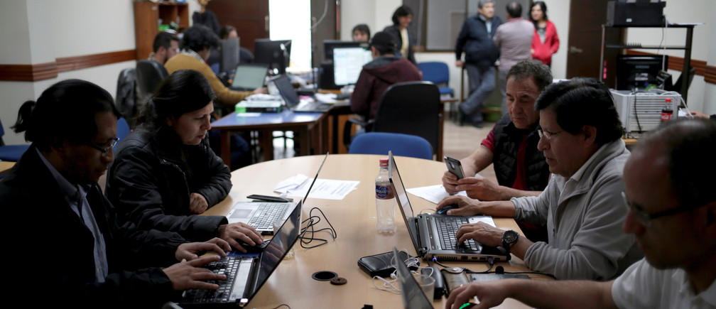 Workers of the Independent Election computing Center from the electoral social control are pictured during the presidential election in La Paz, Bolivia October 20, 2019. REUTERS/David Mercado - RC173427AEB0