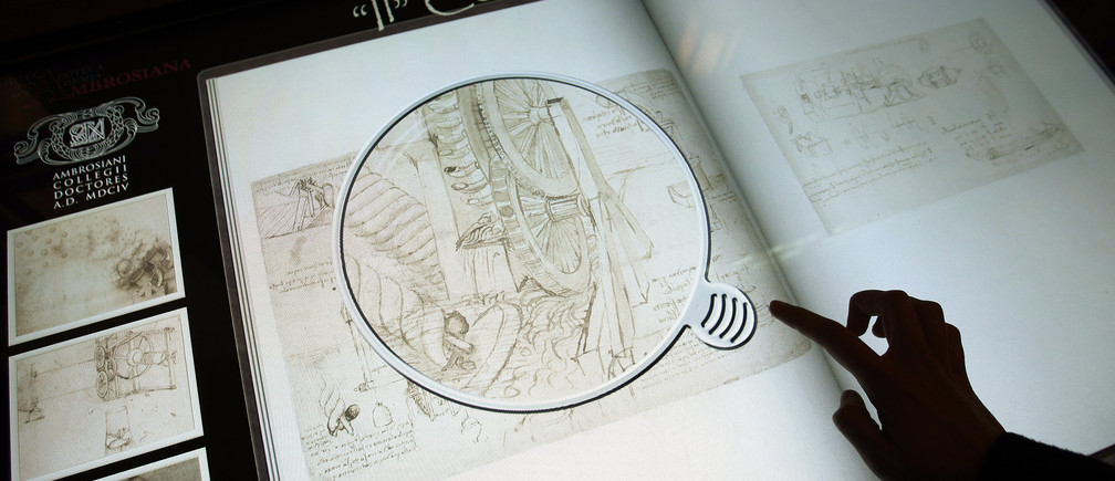 "An electronic ""book"" at the Biblioteca Ambrosiana library shows the Atlantic Code drawn by Leonardo Da Vinci, in downtown Milan March 23, 2009. Experts have begun unbinding Leonardo Da Vinci's 12-volume Atlantic Code, a move they say will help preserve the Italian master's largest collection of drawings and writings and allow some pages to go on display. REUTERS/Alessandro Garofalo (ITALY SCI TECH) - GM1E53N1UKD01"