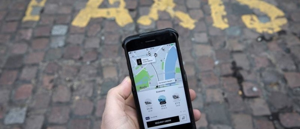 A photo illustration shows the Uber app on a mobile telephone, as it is held up for a posed photograph, in London, Britain November 10, 2017.  REUTERS/Simon Dawson - RC1976331390