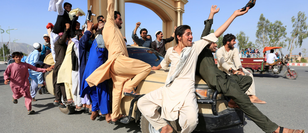 People celebrate ceasefire in Rodat district of Nangarhar province, Afghanistan June 16, 2018.REUTERS/Parwiz     TPX IMAGES OF THE DAY - RC1743BED220