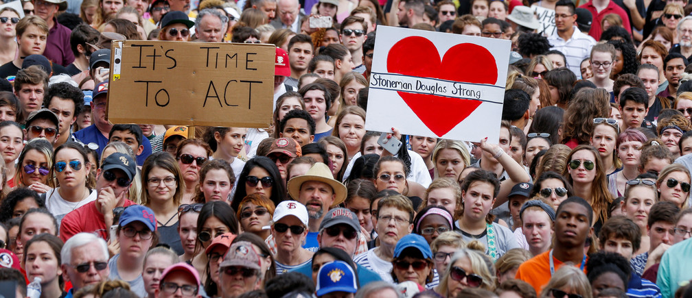 Protestors rally outside the Capitol urging Florida lawmakers to reform gun laws, in the wake of last week's mass shooting at Marjory Stoneman Douglas High School, in Tallahassee, Florida, U.S., February 21, 2018. REUTERS/Colin Hackley - RC1A5EAE9000