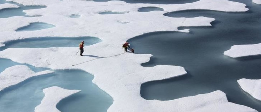 The crew of the  U.S. Coast Guard Cutter Healy, in the midst of their ICESCAPE mission, retrieves supplies in the Arctic Ocean in this July 12, 2011 NASA handout photo.  Kathryn Hansen/NASA via REUTERS/File Photo       ATTENTION EDITORS - THIS IMAGE WAS PROVIDED BY A THIRD PARTY. EDITORIAL USE ONLY.