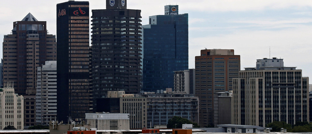 The buildings with the logos of three of South Africa's biggest banks, ABSA, Standard Bank and First National Bank (FNB) are seen against the city skyline in Cape Town, South Africa, August 30, 2017. Picture taken August 30, 2017. REUTERS/Mike Hutchings - RC199A8F64C0