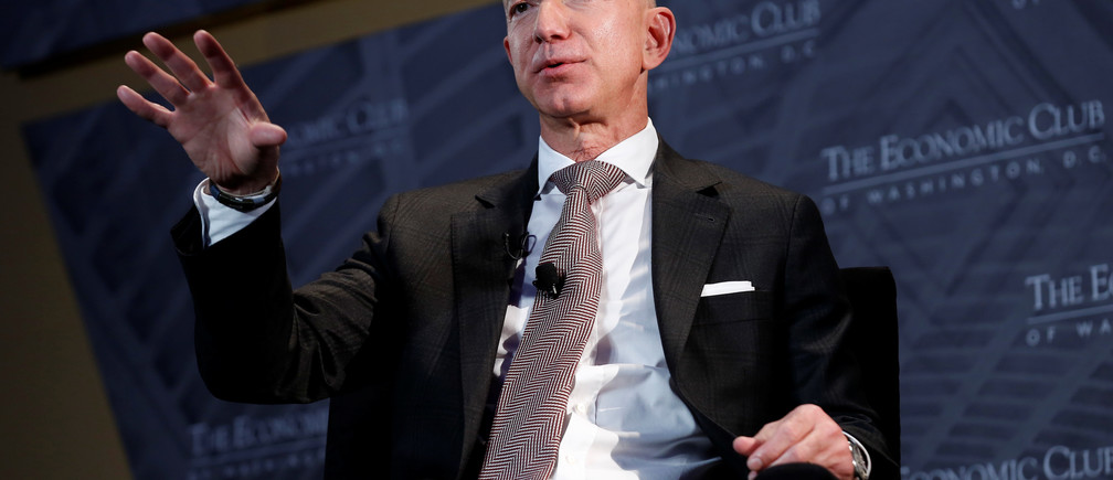 "Jeff Bezos, president and CEO of Amazon and owner of The Washington Post, speaks at the Economic Club of Washington DC's ""Milestone Celebration Dinner"" in Washington, U.S., September 13, 2018.      REUTERS/Joshua Roberts - RC1E8F0B3400"