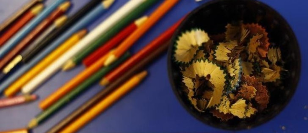 Pencils and pencil shavings are seen on a desk at Watlington Primary School in Watlington, southern England December 14, 2011. On Thursday the Department of Education will publish primary school league tables.     REUTERS/Eddie Keogh (BRITAIN - Tags: POLITICS EDUCATION)