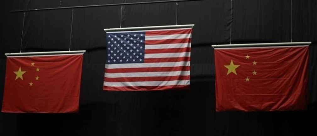 Aug 6, 2016; Rio de Janeiro, Brazil; The American flag flies above the Chinese flags after Virginia Thrasher took the gold medal in the 10m air rifle competition at Olympic Shooting Centre. Mandatory Credit: Geoff Burke-USA TODAY Sports  Picture Supplied by Action Images