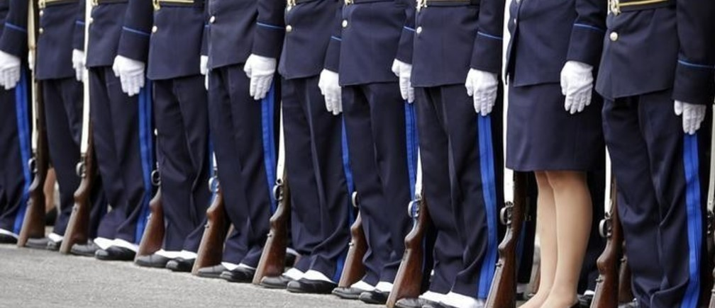 Police officers participate in a parade during the celebration of the 183rd anniversary of the Uruguayan Police Force in downtown Montevideo, December 18, 2012.  REUTERS/Andres Stapff (URUGUAY - Tags: ANNIVERSARY CRIME LAW)