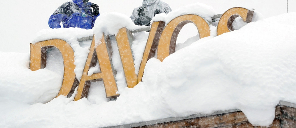 Snipers hold their position on the roof of a hotel during the World Economic Forum (WEF) annual meeting in the Swiss Alps resort of Davos, Switzerland January 22, 2018.