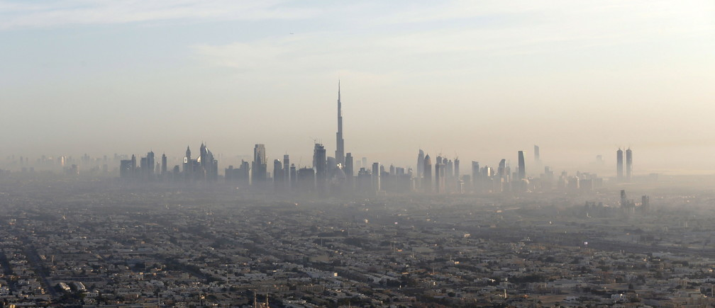 A general view of Dubai and the world's tallest tower, the Burj Khalifa (C), December 9, 2015. Photo taken December 9, 2015.  REUTERS/Karim Sahib/Pool - RTX1Y3EF
