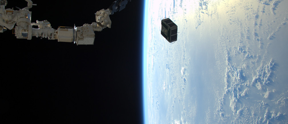 The robotic arm in Japan's Kibo laboratory successfully deploys two combined satellites from Texas universities from the International Space Station, January 29, 2016. The pair of satellites -- AggieSat4 built by Texas A&M University students, and BEVO-2 built by University of Texas students -- together form the Low Earth Orbiting Navigation Experiment for Spacecraft Testing Autonomous Rendezvous and Docking (LONESTAR) investigation.    REUTERS/NASA/Tim Peake/Handout   ATTENTION EDITORS - FOR EDITORIAL USE ONLY. NOT FOR SALE FOR MARKETING OR ADVERTISING CAMPAIGNS. THIS PICTURE WAS PROVIDED BY A THIRD PARTY. REUTERS IS UNABLE TO INDEPENDENTLY VERIFY THE AUTHENTICITY, CONTENT, LOCATION OR DATE OF THIS IMAGE. THIS PICTURE IS DISTRIBUTED EXACTLY AS RECEIVED BY REUTERS, AS A SERVICE TO CLIENTS - TM3EC311KOA01