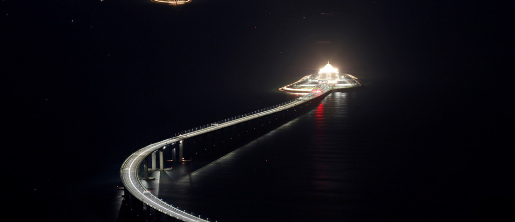An evening view of the Hong Kong-Zhuhai-Macau bridge and its entrances to a cross sea tunnel, off Lantau island in Hong Kong, China October 21, 2018, before its opening ceremony on October 23, 2018. Picture taken October 21, 2018.    REUTERS/Bobby Yip     TPX IMAGES OF THE DAY - RC1D8AEFCA80