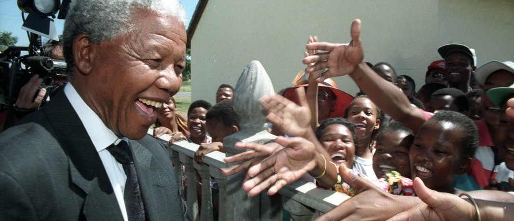 African National Congress (ANC) leader Nelson Mandela greets residents of Mmabatho March 15, 1994, during a visit after the nominal homeland came under South African control following the ousting of the former President Lucas Mangope. SCANNED FROM NEGATIVE. REUTERS/Howard Burditt  HB/CMC/PN - RP1DRICQZSAD