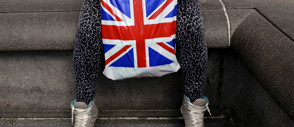 "A woman holds a Union Flag shopping bag in London, Britain April 23, 2016.  REUTERS/Kevin Coombs/File Photo    GLOBAL BUSINESS WEEK AHEAD PACKAGE - SEARCH ""BUSINESS WEEK AHEAD JULY 18"" FOR ALL IMAGES - S1AETQFANIAA"