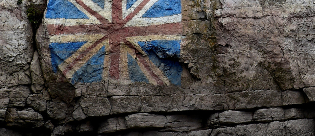 A painted Union Flag, popularly known as the Union Jack, the national flag of the United Kingdom is seen on the rocks on the English side of the River Wye, Chepstow, Wales, March 28, 2017. REUTERS/Rebecca Naden - RTX333G4