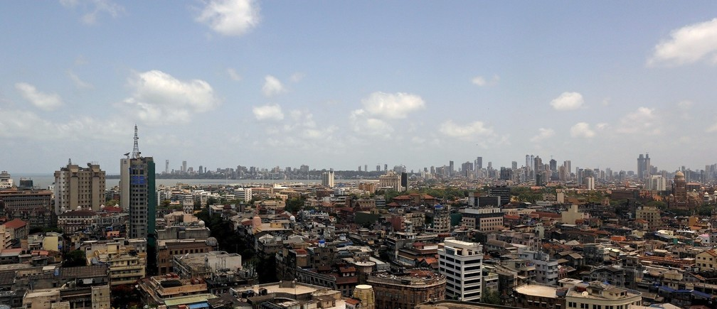 Scattered clouds are seen over Mumbai's skyline, India, June 2, 2015. India cut this year's forecast for monsoon rains to 88 percent of the long-term average, Earth Sciences Minister Harsh Vardhan said on Tuesday, raising fears of a drought in the country where nearly half of farmland lacks irrigation facilities. REUTERS/Danish Siddiqui - RTR4YFTM