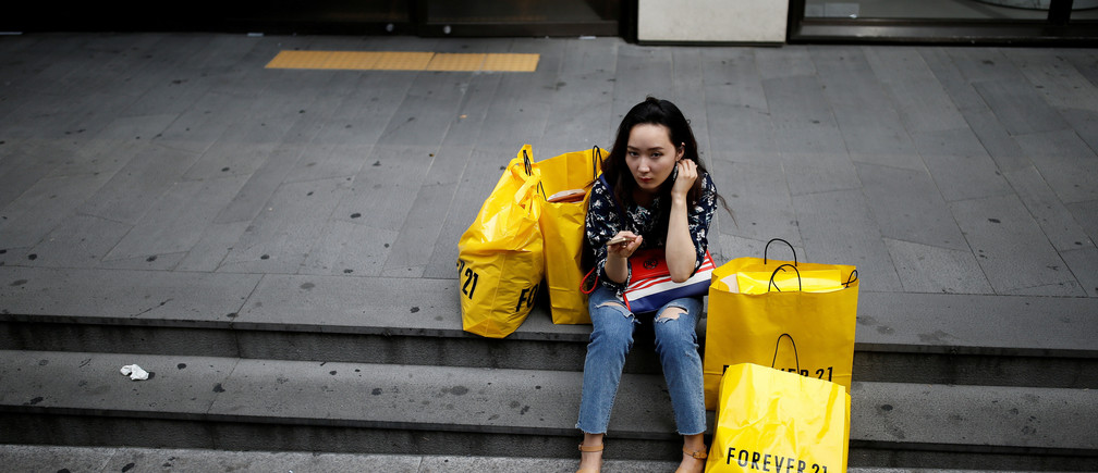 A woman uses her mobile phone at Myeongdong shopping district in Seoul, South Korea, August 29, 2016.    REUTERS/Kim Hong-Ji/File Photo                                   GLOBAL BUSINESS WEEK AHEAD PACKAGE Ð SEARCH ÒBUSINESS WEEK AHEAD 3 OCTÓ FOR ALL IMAGES - RTSQGT3