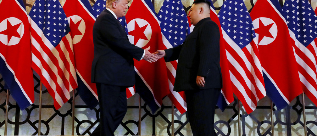 North Korea's leader Kim Jong Un walks with U.S. President Donald Trump during the second North Korea-U.S. summit in Hanoi, Vietnam, in this photo released on March 1, 2019 by North Korea's Korean Central News Agency (KCNA).  KCNA via REUTERS    ATTENTION EDITORS - THIS IMAGE WAS PROVIDED BY A THIRD PARTY. REUTERS IS UNABLE TO INDEPENDENTLY VERIFY THIS IMAGE. NO THIRD PARTY SALES. SOUTH KOREA OUT. NO COMMERCIAL OR EDITORIAL SALES IN SOUTH KOREA. - RC1B02ED9E00