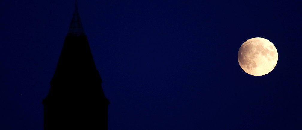 A tower of a building at Steglitz district is pictured beside a partial lunar eclipse in Berlin, Germany, July 16, 2019. REUTERS/Fabrizio Bensch - RC1AEA41E700