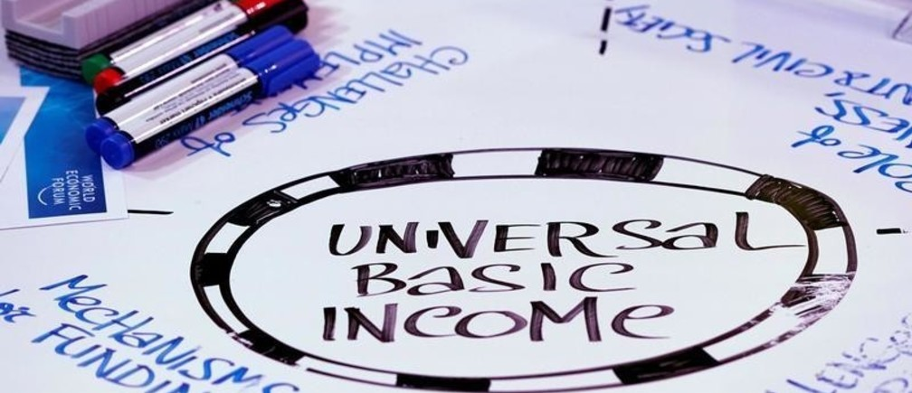 Universal Basic Income (UBI) s written on a table during a session at the World Economic Forum (WEF) annual meeting in Davos, Switzerland January 23, 2018  REUTERS/Denis Balibouse - RC12307A4F80